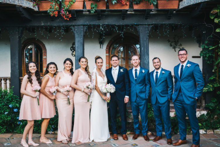 The bridesmaids were rocking mismatched blush dresses of different length