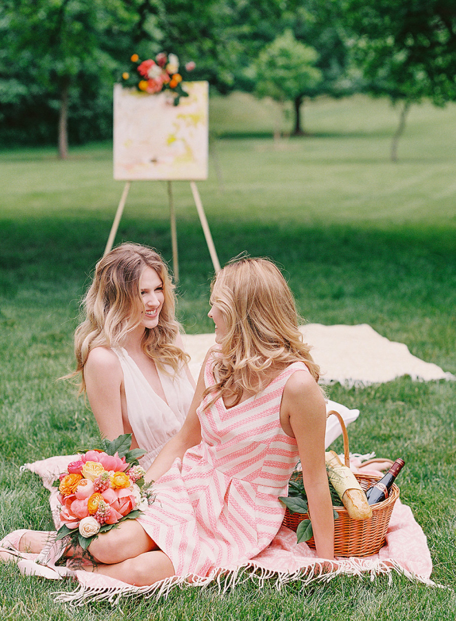 The bridesmaids were rocking mismatched striped dresses in cute pink tones