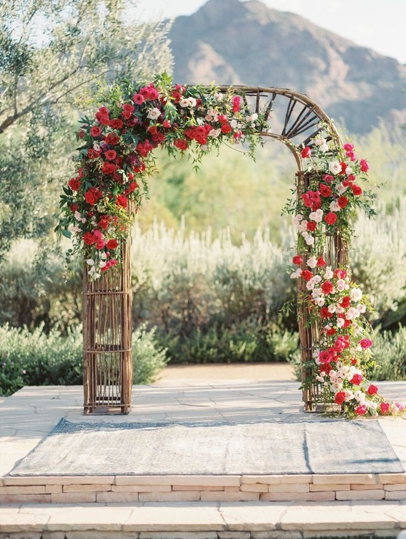 The wedding arch was a wicker one, with lush bold flowers