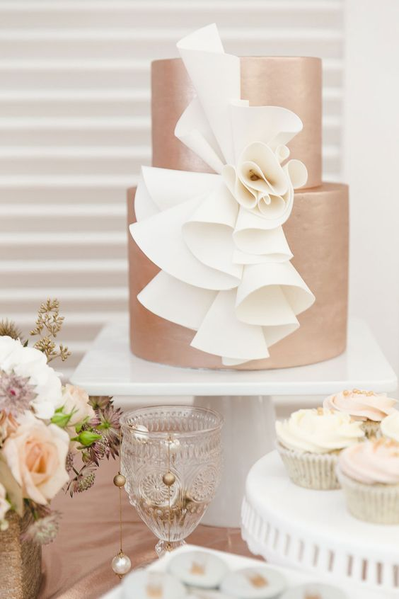 copper wedidng cake with unique white cream decor