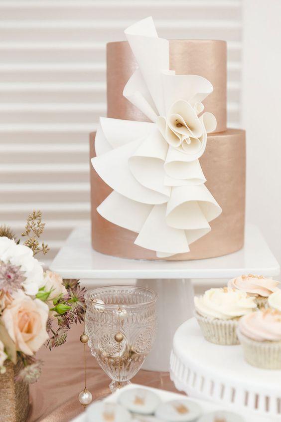 copper wedidng cake with unique white cream decor