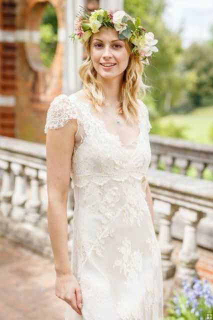 ivory lace wedding dress with cap sleeves and a high waist