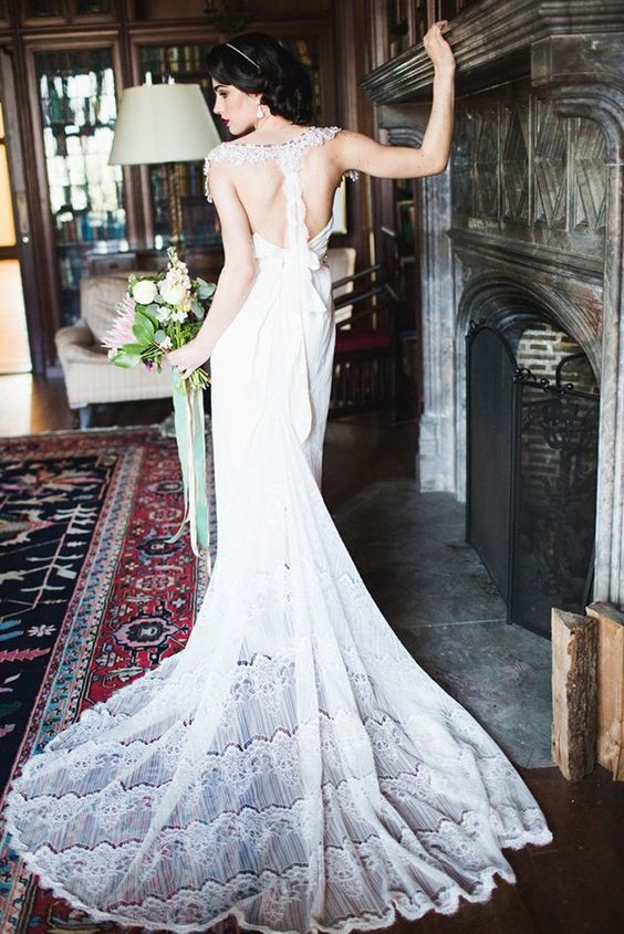 relaxed wedding gown with a train and a lace racerback with a bow