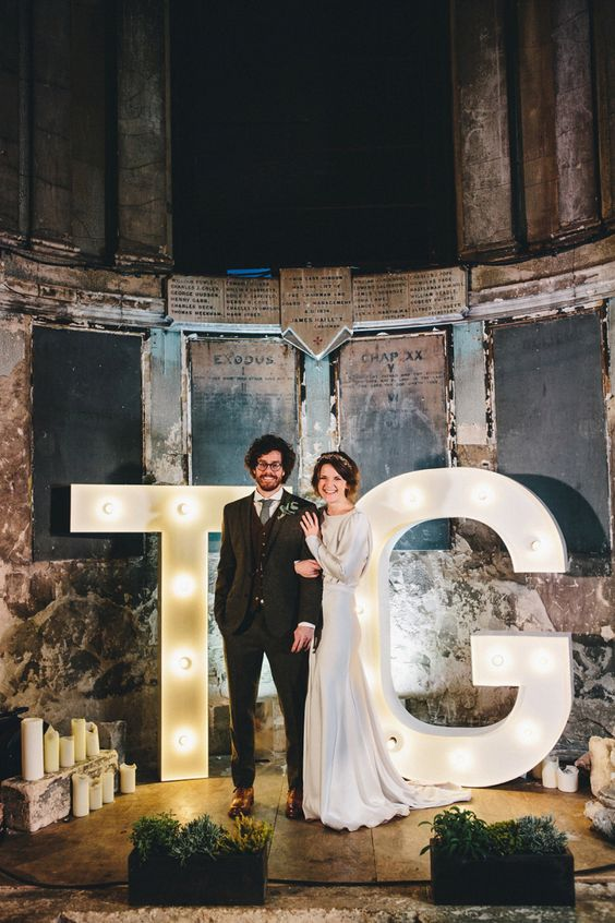 vintage industrial wedding venue and oversized monogram marquee letters