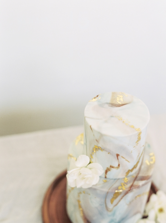 The wedding cake was a trendy marble one with gold touches and pieces of quartz on top