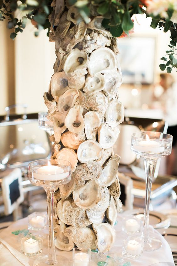 a table centerpiece designed with oyster shells is great idea for a reception on the water