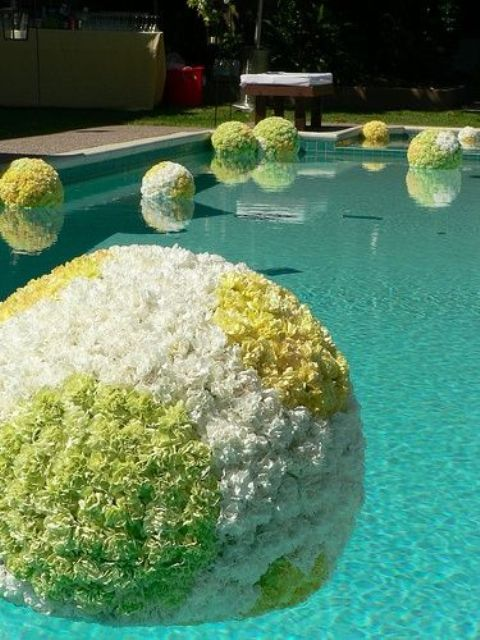 floating flower spheres in the pool for cute decor