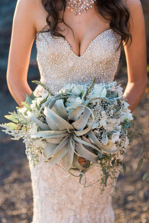 heavily beaded and pearled wedding dress and a pearl necklace
