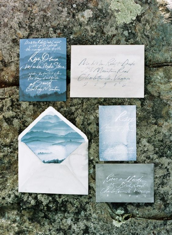 watercolor wedding stationary in shades of blue and grey with calligraphy