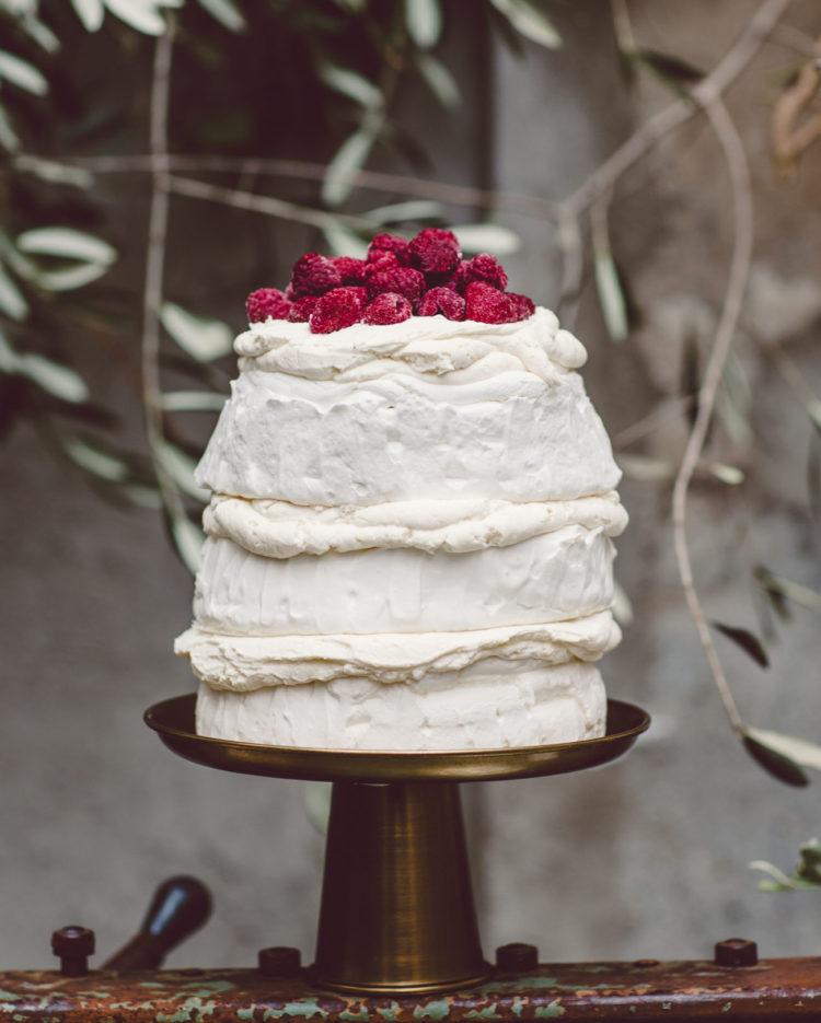 Pavola wedding cake with fresh raspberries