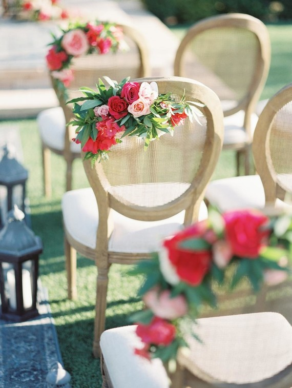 The chairs were decorated with floral posies for a bold eye-catchy look