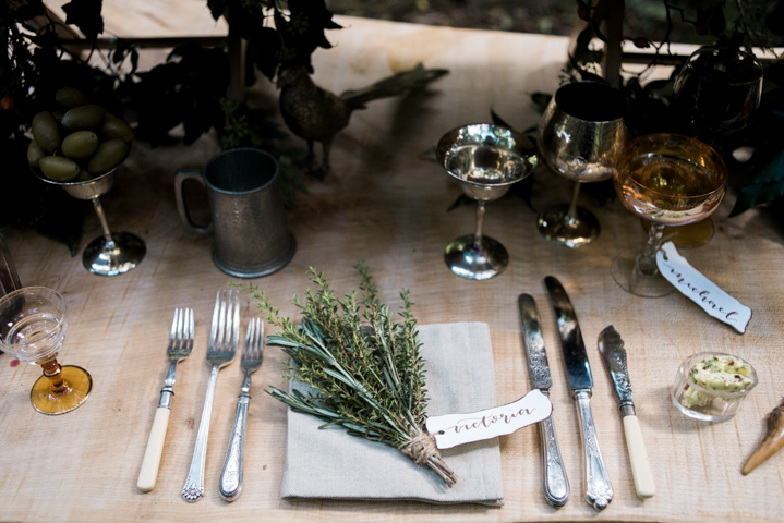 Vintage silverware and herbs with a place card for a place setting