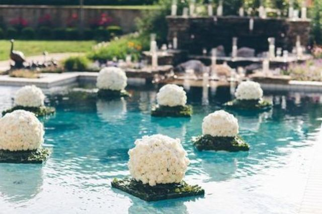 floating flower and greenery sculptures right in the pool