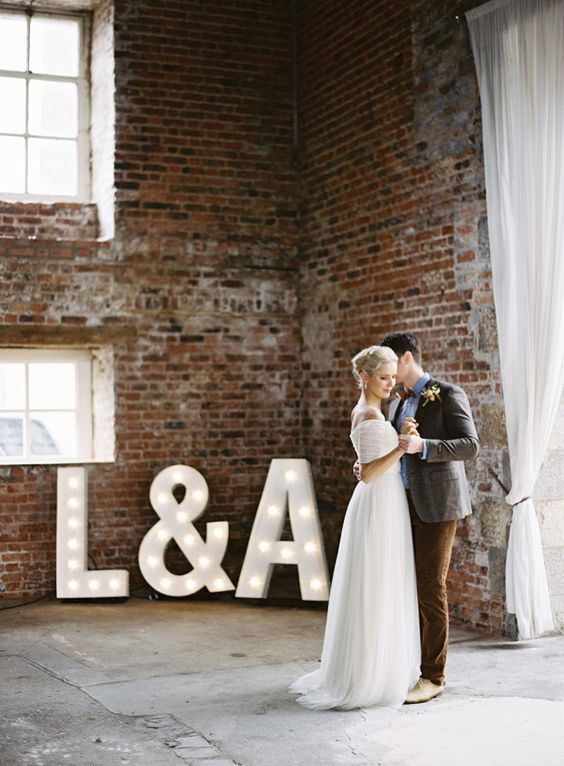 marquee monogram lighting in an industrial loft wedding venue