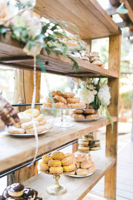 simple rustic donut bar decorated with flowers and greenery