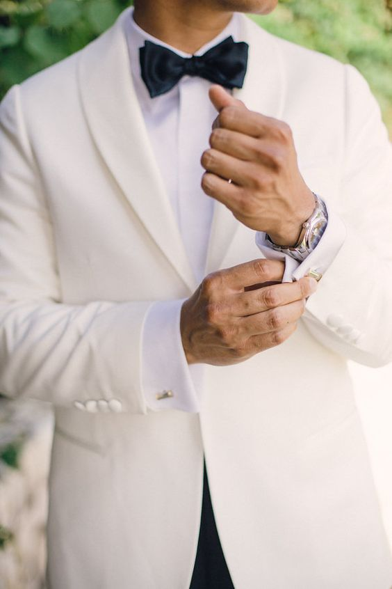 a white tuxedo is classics, which will easily fit any color scheme