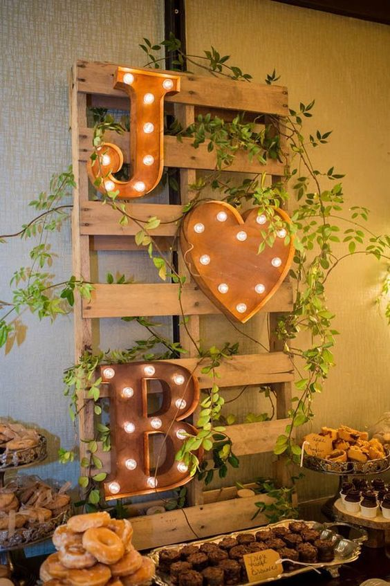 rustic dessert table display with marquee monograms