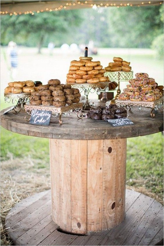rustic donut bar on a large wooden spool