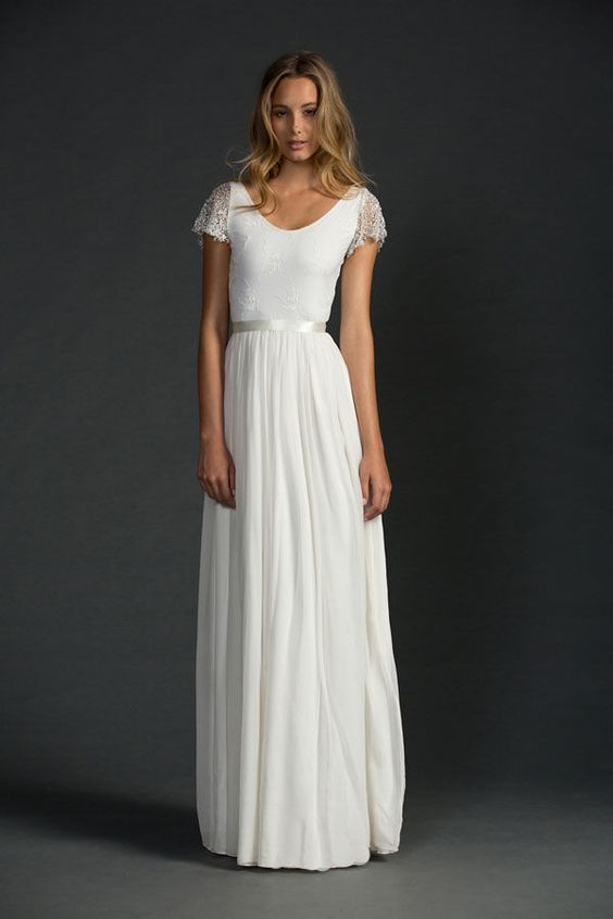 simple white wedding dress with cap sleeves, scoop neck and ribbon sash