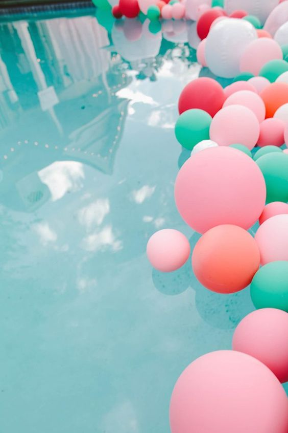 colorful balloons in the pool for a vibrant wedding