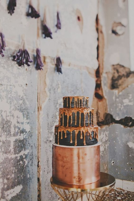copper and chocolate wedding cake with drip