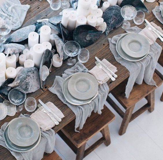 grey fabric for each place setting, large shells and candles