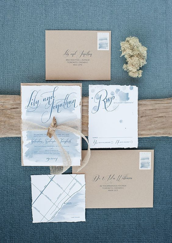 kraft paper envelopes, light blue watercolor wedding stationary with driftwood attached