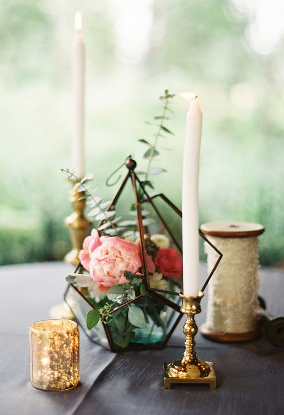 12 chic centerpiece with a dark metal terrarium filled with eucalyptus and peonies and candles