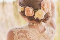 12 large fresh blooms for a twisted wedding updo