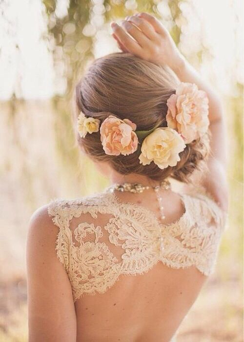 large fresh blooms for a twisted wedding updo