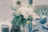13 blues and greys plus flowers and candles for a beautiful sea-inspired table setting