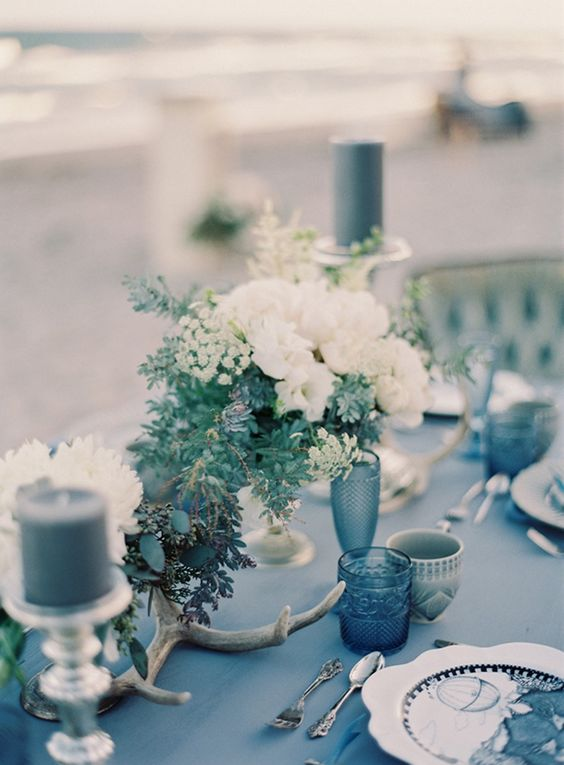 blues and greys plus flowers and candles for a beautiful sea-inspired table setting