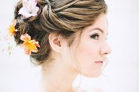 13 elegant wedding updo with tropical blooms in it