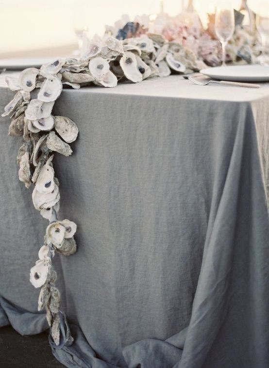 grey tablecloth and an oyster garland for a nautical tablescape