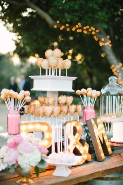 dessert table with monogram marquee letters
