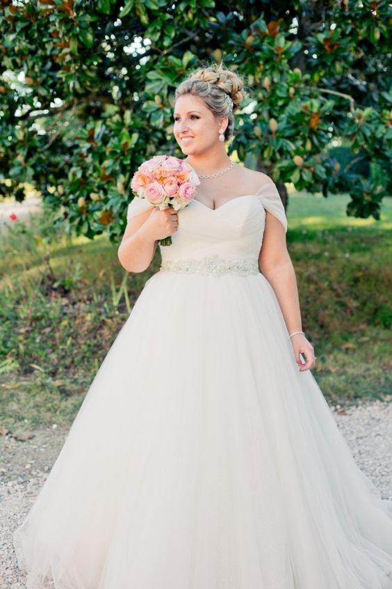 empire waist bridal gown with beading at the high waist and cap sleeves