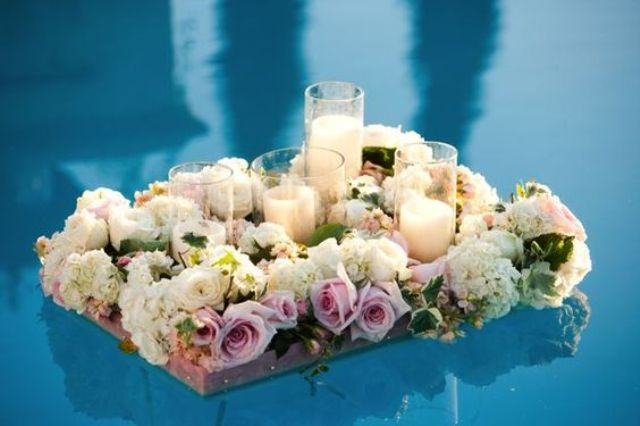 floating frames with lush flowers and candles