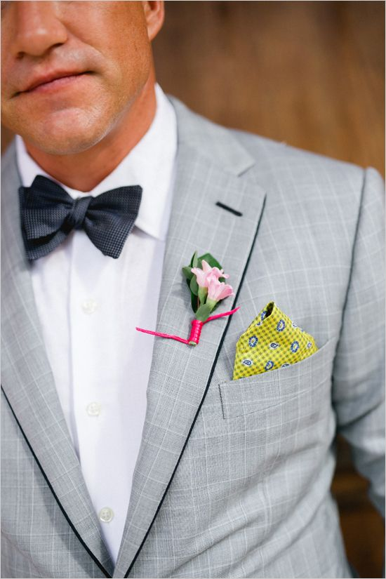 light grey suit, a white shirt, a dark bow tie and bold elements