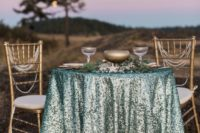 15 aqua sequin tablecloth with gold details makes this sweetheart table adorable