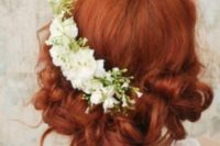 15 curly wedding updo with fresh white flowers on one side