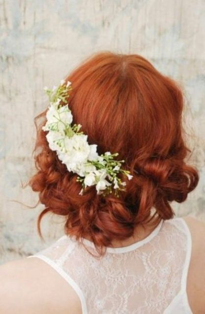 curly wedding updo with fresh white flowers on one side