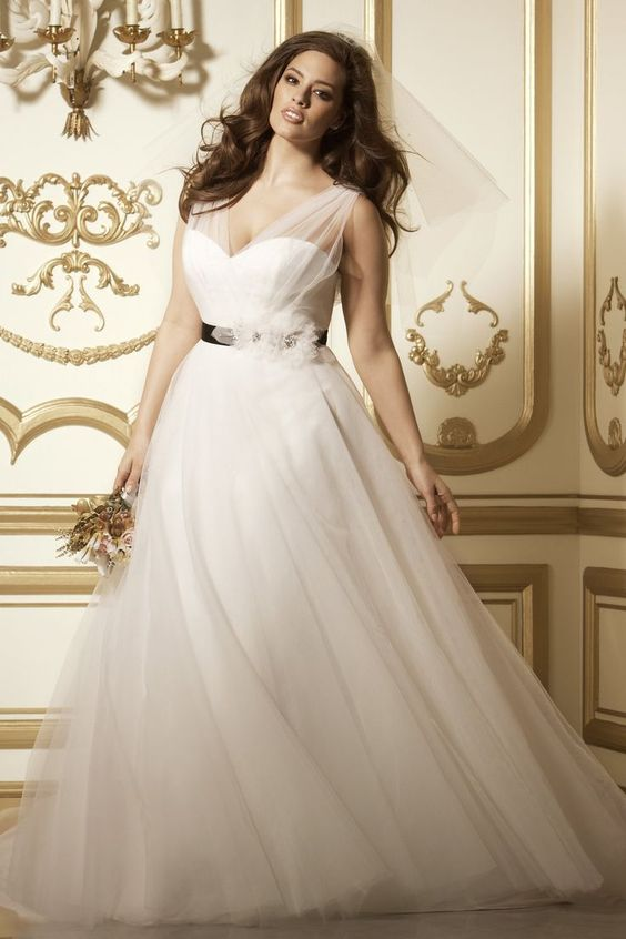 ethereal wedding dress of tulle with illusion strapes and a sweetheart neckline