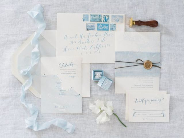 light shades of blue and cute stamps for a beachside wedding