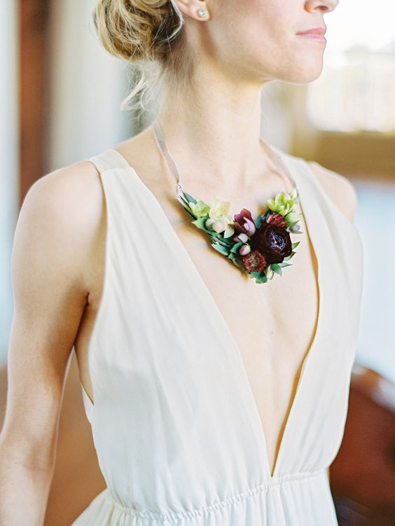 moody flower necklace highlights the plunging neckline