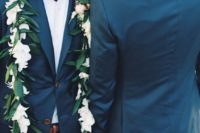 15 navy blue suits, white shirts, bow ties and floral garlands for both grooms
