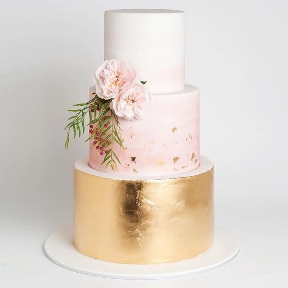 one tier in metallic gold, another in blush and the ttop is in white