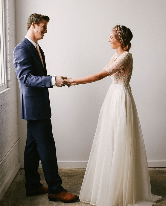 ivory lace bodice with short sleeves and a tulle skirt