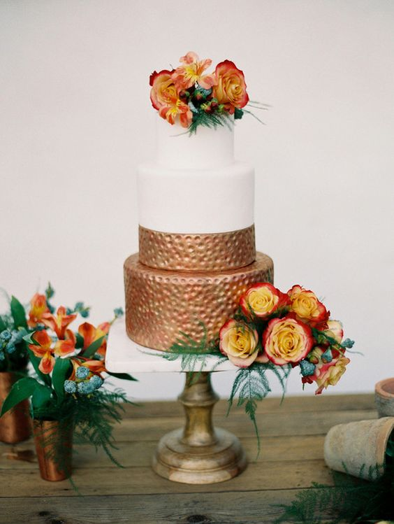 half white and half copper wedding cake with bold flowers
