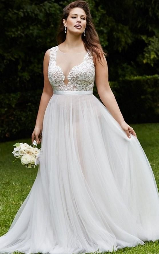 illusion plunging neckline wedding gown with a lace bodice and a plain skirt