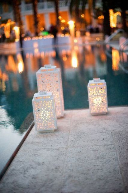 laser cut candle lanterns to light up the pool